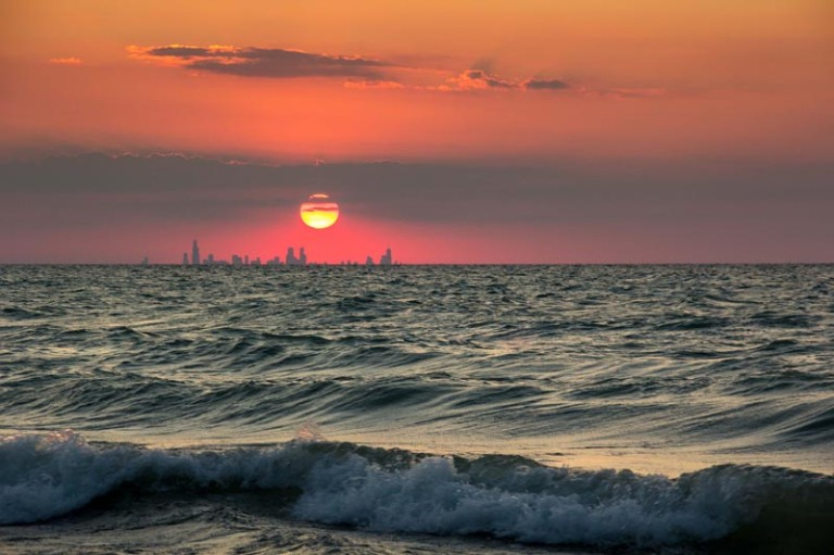 chicago-skyline-from-indiana-sunset-across-water